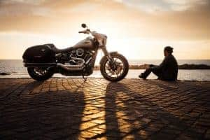 Man and motorcycle beside the sea